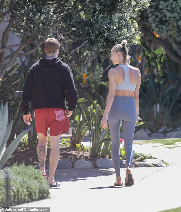 Model looks: Hailey looked very toned as the couple walked away together