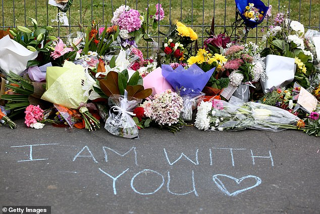 Locals said the flowers had begun flowing in about 9am on Saturday morning, and most of the tributes stuck to the fence had appeared overnight