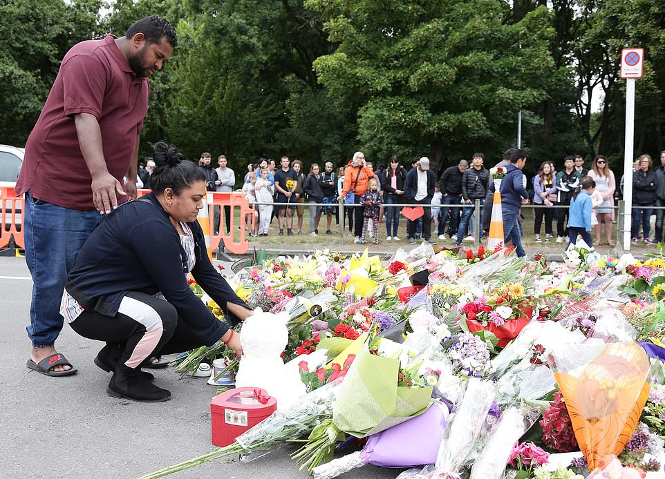 A large pile of tributes begins to form outside theAl Noor mosque in Christchurch, one of the locations where AustralianBrenton Tarrant is said to have opened fire on worshippers at Friday prayer