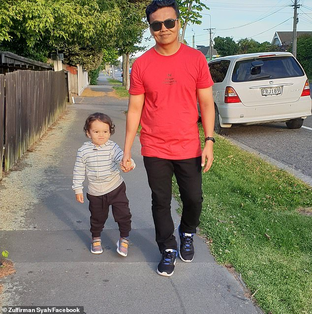 The brave father was shot several times to his body but shielded his son (who he is pictured with) for enough time for others to chase the gunman away