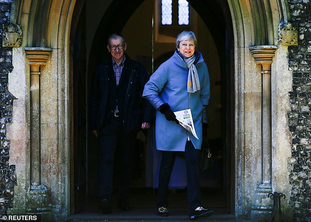 Despite the positive signs Mrs May (seen today outside church) still faces a difficult task ahead, with senior ERG figures predicting she will lose her third vote by 'well over 100 votes'