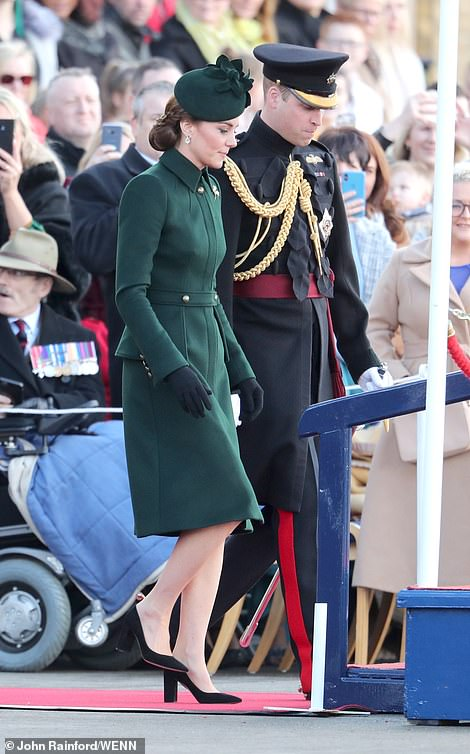 Paying sartorial tribute to Ireland's national day, Kate donned traditional green, teaming a military style coat with a black floral hat