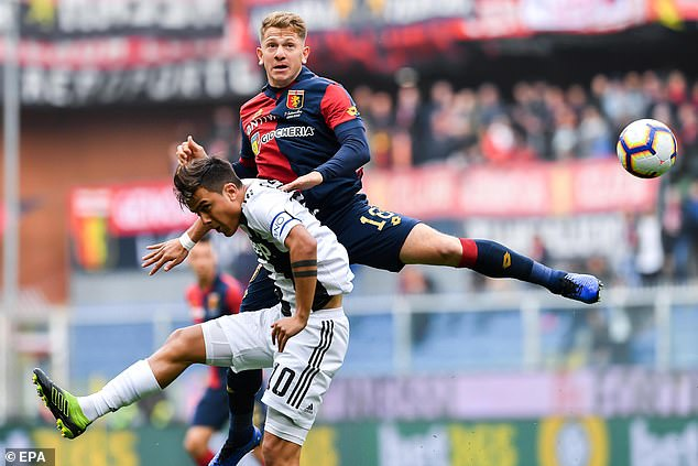 Genoa midfielder Esteban Rolon battles for possession with Juventus star Paulo Dybala