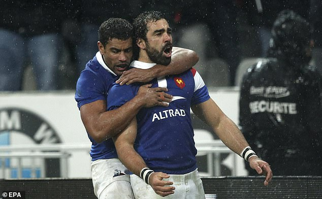 France wing Yoann Huget (right) earns the agonising howler award for his error against Wales