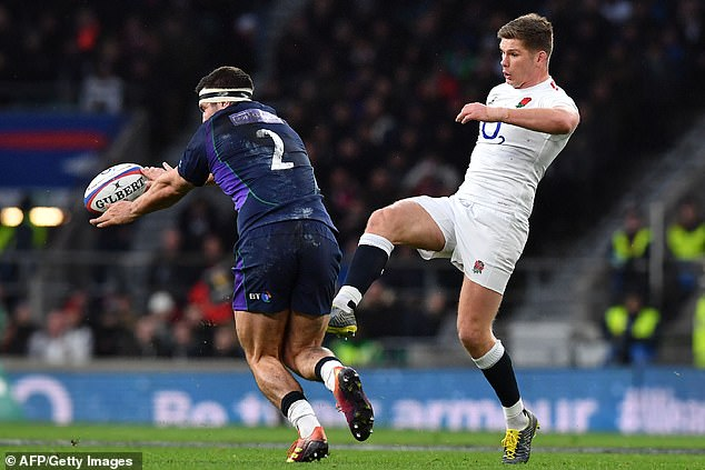 Scotland hooker Stuart McInally charges down Farrell's kick before running through to score