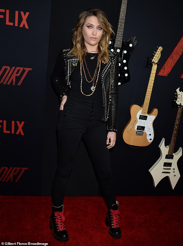 Parisian style: Jackson wore a black top under a studded black leather jacket, with black trousers and black boots with red laces