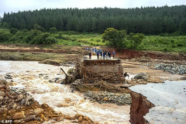 Stranded: Loggers on a damaged road on Charter Estate, Chimanimani