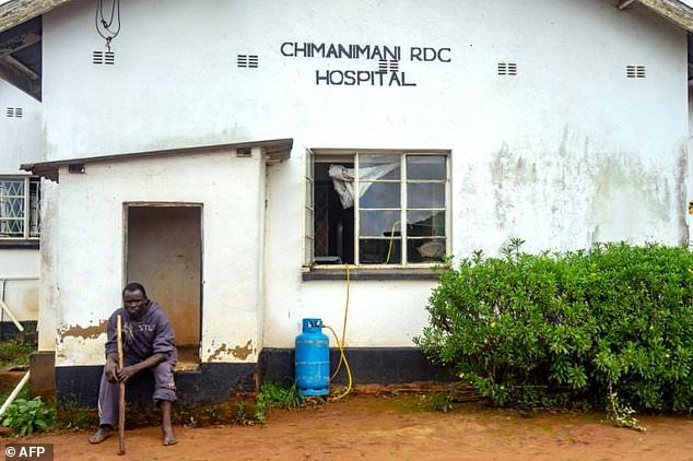 A cyclone survivor sits outside Chimanimani Rural District Hospital