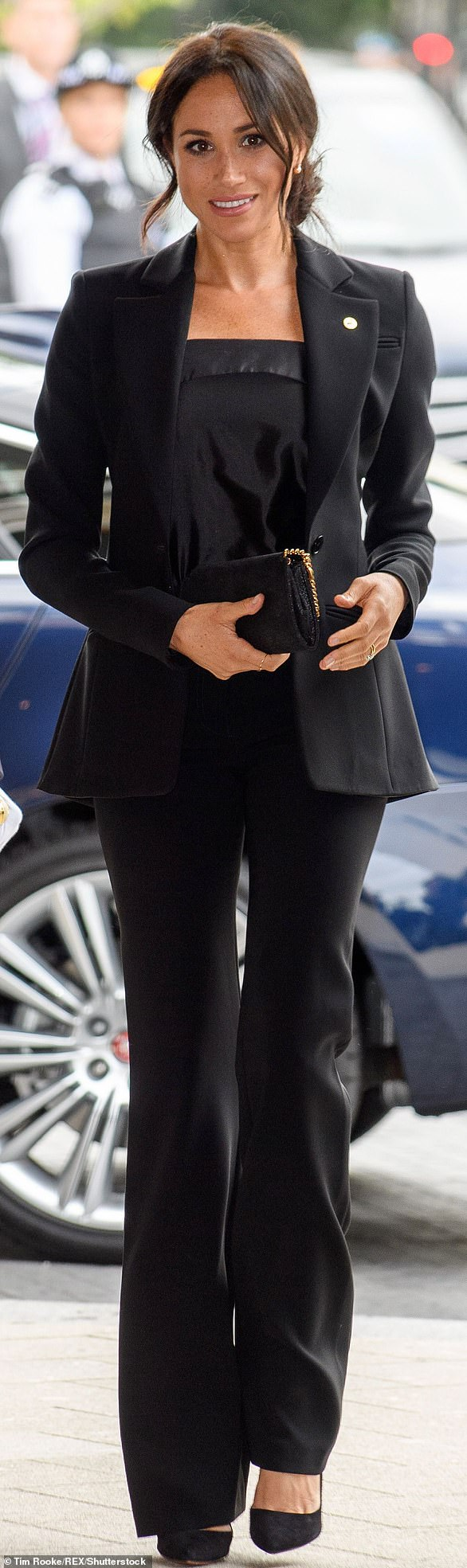 dfaebe26e Meghan pinned her hair back and wore all black including a Acacia  One-Button Blazer