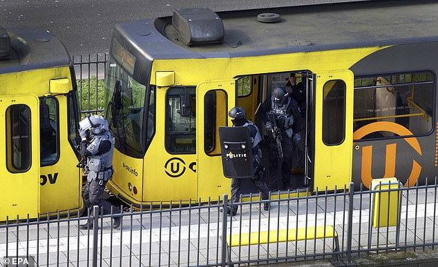 Emergency: Dutch special police forces inspect the tram in Utrecht after a gunman opened fire in the public transport carriage and killed three people