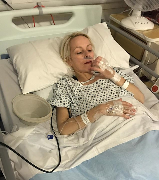 Mrs Thomas, a mother-of-three, lost two stone in a month when her health took a turn for the worst. She had been on the waiting list to have a fibroid in her womb removed. Pictured in hospital after the removal of the growth which weighed 5lb