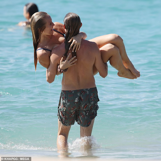 Affectionate: On the beach outing, Sailor and Ben packed on the PDA for all to see