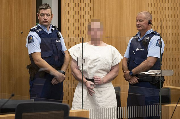 Brenton Tarrant making a sign to the camera during his appearance in the Christchurch District Court