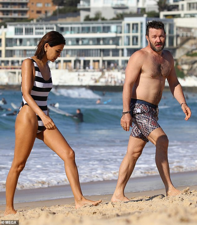 Hollywood hunk! Meanwhile, Los Angeles-based Joel made the most of Australia's warm weather by stripping down to a pair of patterned swimming trunks