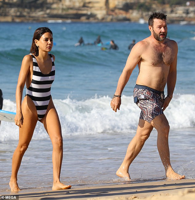 Still going swimmingly! Australian actor Joel Edgerton, 44, and his Vogue fashion director girlfriend, Christine Centeneramade a rare appearance as a couple on Saturday morning as they stepped out for a swim at Bondi Beach