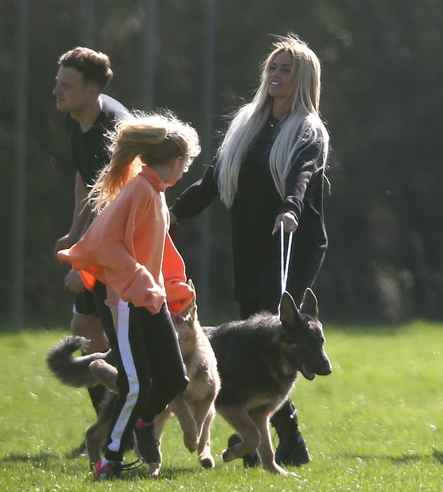 Fun times: the glamorous model made the most of the sun, taking with her the German shepherd Bear