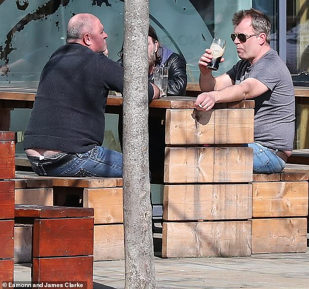 Welcome break: That drama surrounding his latest storyline was forgotten as Coronation Street star Simon Gregson enjoyed a quiet pint during a break between scenes in Manchester on Monday afternoon