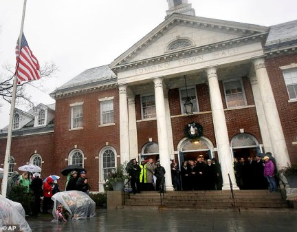 Police said they were called to the Edmond Town Hall where Richman has an office at about 7am on Monday to investigate reports of a suicide. The hall is pictured above during a memorial for the Sandy Hook victims