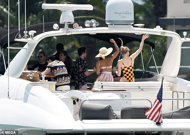 Living it up!The actress appeared in great spirits as she and Nick's new wife Priyanka giddily waved their hands in air during their time on the watercraft
