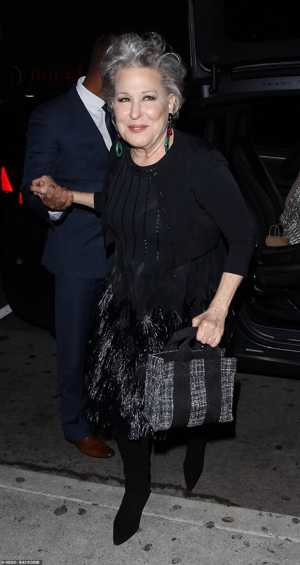 Star-studded guest list: Hollywood legend Bette Midler was super chic in her black tasselled skirt