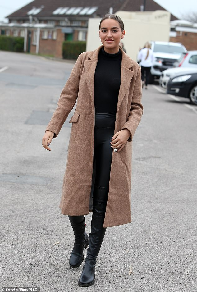 Sleek: The tanned beauty pulled her brunette tresses into a low up-do, with her dynamic centre-part on full display
