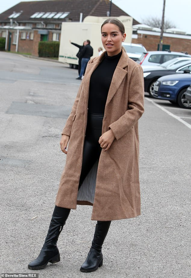 Simple: Fellow newbie Chloe Ross opted for a simple look, teaming an oversized brown coat with all-black and knee-high boots