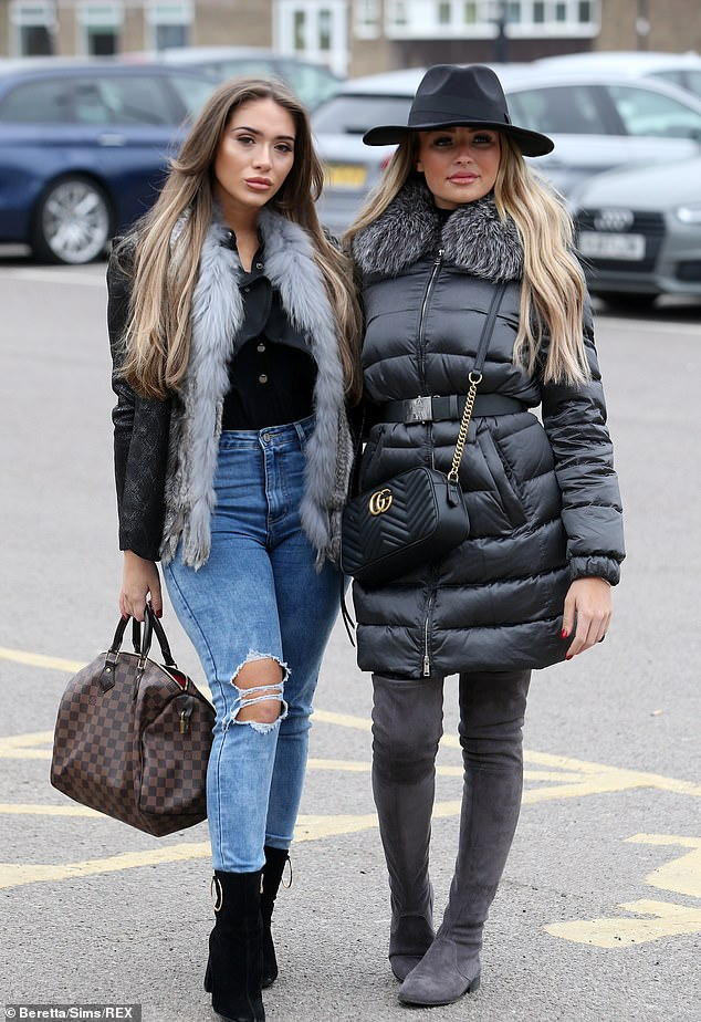 Cosy: She was also seen posing up a storm with fellow newcomer Ella Wise, who all bundled up in a black padded jacket