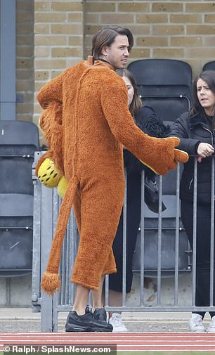 Animal antics: He playfully showed it off on the pitch