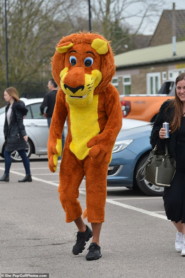 Quiet: James tried to go unnoticed as he donned his lion outfit, and made a sly entrance into the stadium