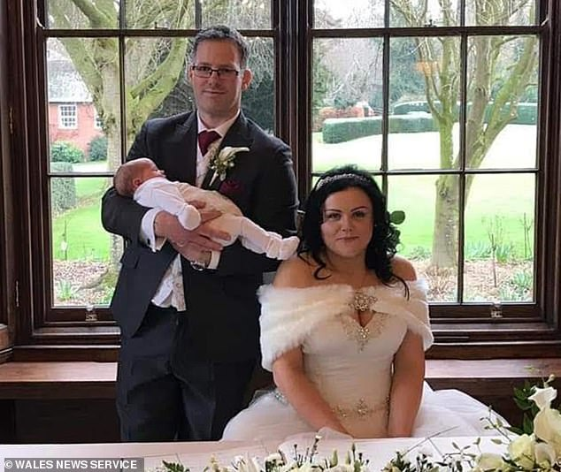 Mr and Mrs Smith, pictured on their wedding day in February, two weeks after Evie was born, conceived their daughter using IVF and had the embryo implanted into Mrs Smith's mother