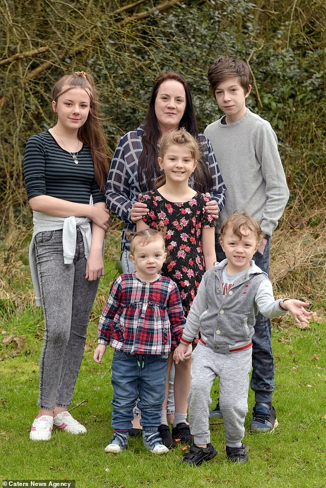 A mother has described her five children as 'miracles' after doctors told her it was unlikely she would ever conceive. She is pictured in the centre with her children (left-to-right) Ellie-Jayne Dodd-Sutton, 13, Elizabeth-Ann Hopkins, two, Annabelle Dodd-Sutton, nine, Harry Dodd-Sutton, 14 and Freddie Hopkins, four