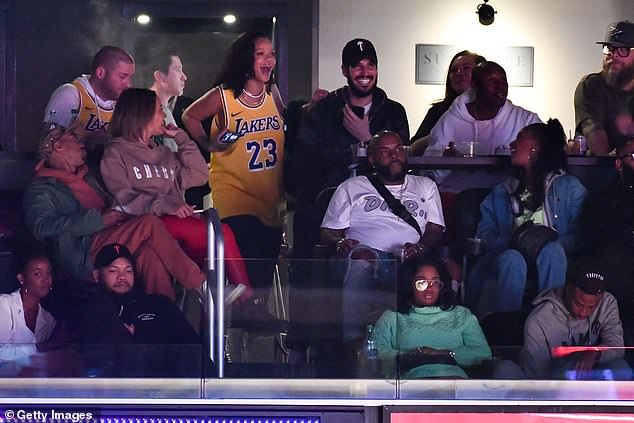 Bad gal: Rihanna pictured in a suite during a Los Angeles Lakers game against the Houston Rockets last month