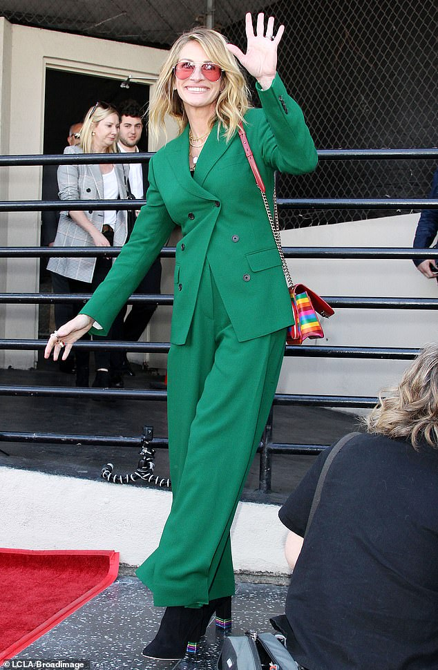 Green spirit:Julia Roberts made quite the impression on Friday when she showed up to the Walk Of Fame ceremony for actress and singer Rita Wilson