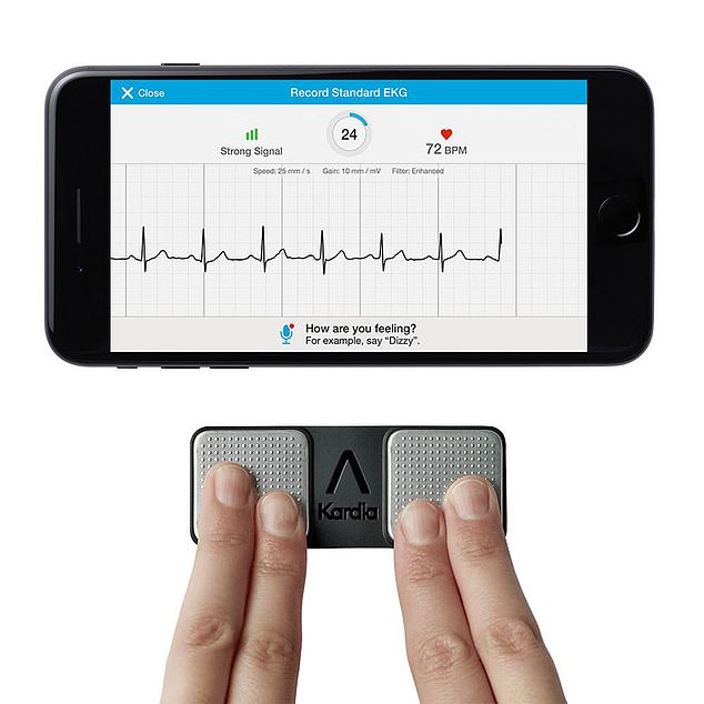 The KardiaMobile device uses two metal pads, pictured, to determine whether a patient has an irregular heart beat, showing the results on their mobile phone using a special app