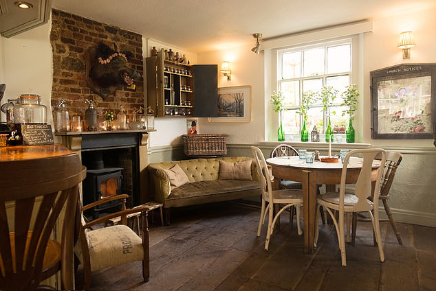 """The Crowd of the Inn: The inviting bar at the Horse Guards Inn, where the atmosphere on Saturday night is described as """"on the right side of the hustle and bustle"""""""