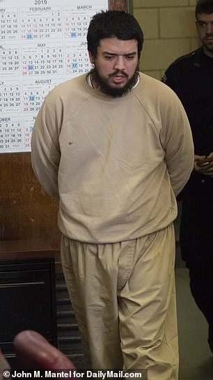 The defendant was escorted into the courtroom in handcuffs
