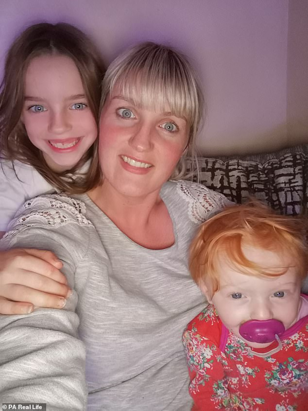 Kelly (pictured centre with Alexis and Sydney) who is proud of her achievement says her weight loss has helped her to find herself