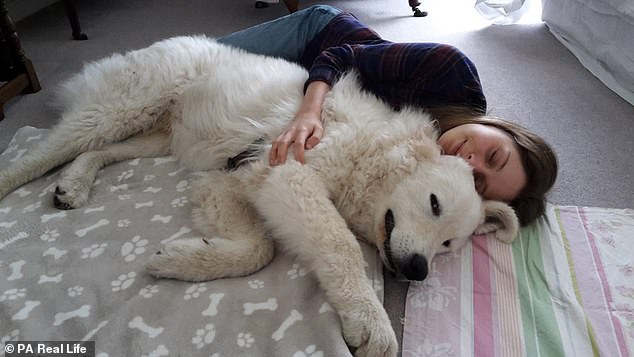 Miss Gamber had an eight-hour operation followed by two more surgeries in November 2017, but they did not relieve her pain. She said her dog is her saviour - pictured together