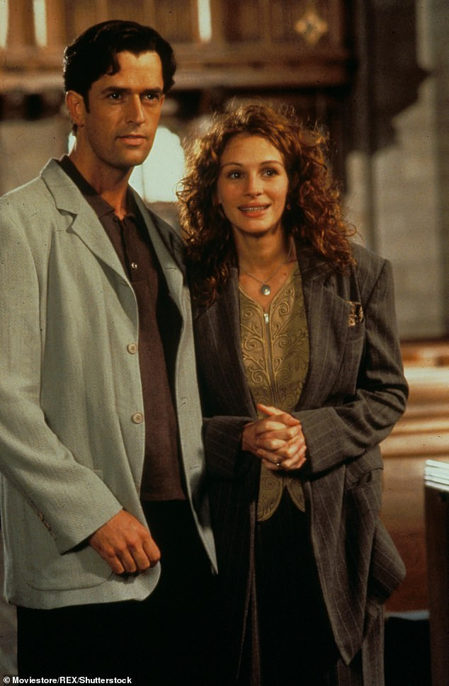 Romantic lead:Rupert became a household name after his huge success in My Best Friend's Wedding in 1997 (pictured), in which he stole the show as Julia Roberts' (right) friend