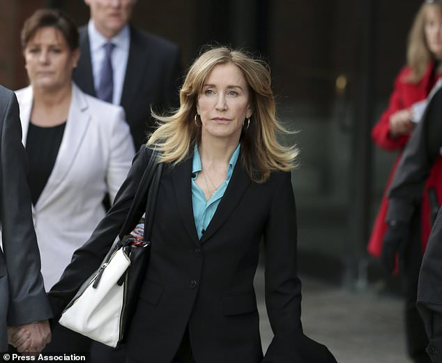 Felicity Huffman leaves the court. Huffman and 12 other parents have agreed to plead guilty