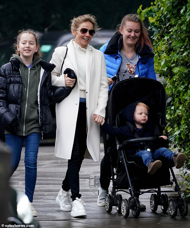 The first family: Geri has a classic chic look with a creamy white top paired with a matching three-quarter coat