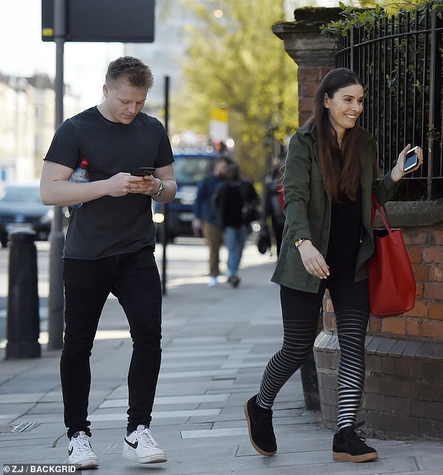 Checking things out: Jack was trawling through his phone while his mum beamed
