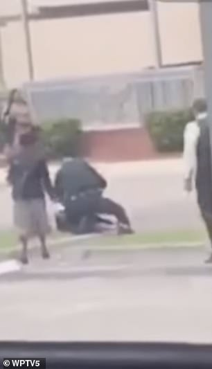 Witnesses rush over to the boy and cop