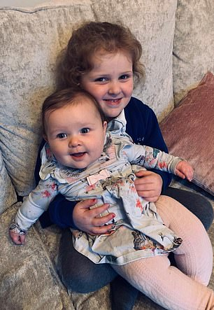 Since the ordeal, Lottie has become a big sister to seven-month-old Florence (pictured together)