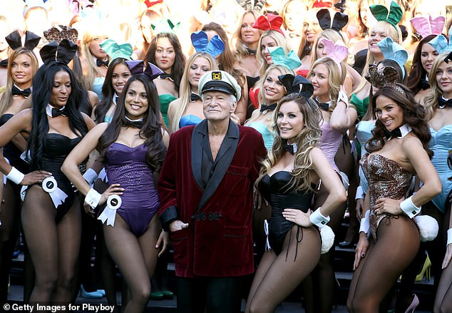 Hugh Hefner (center) poses with Playboy Bunnies Playmate of the Year 2013 Raquel Pomplun (2nd left) and Miss December 2009 Crystal Hefner (2nd right) at Playboy's 60th Anniversary special event on January 16, 2014 in Los Angeles, California