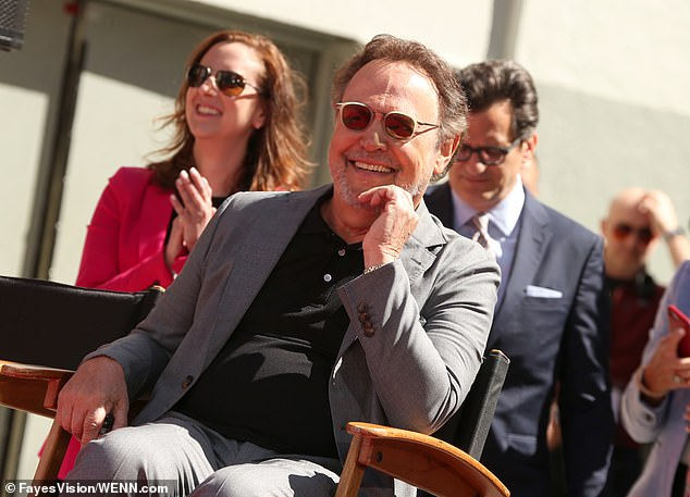 Laugh it up: Rob also took the lectern at the event to give a speech to the revelers, and Billy could be seen thoroughly enjoying himself in the audience