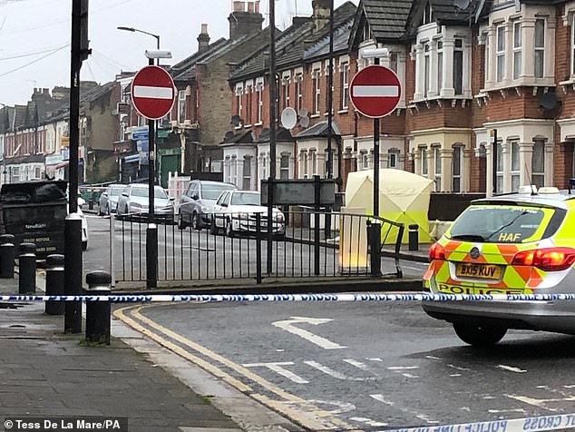 Police remain at the scene in Manor Park, east London, on Tuesday after a man his 20s died