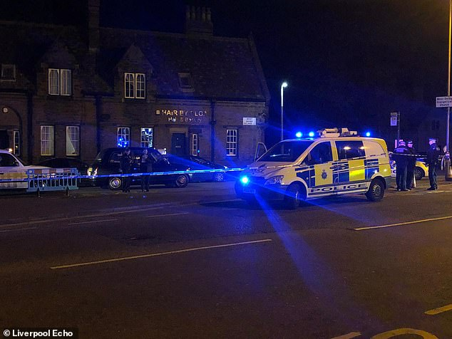 Merseyside police, pictured yesterday, outside the Sefton Arms in Liverpool where an 18-year-old was stabbed in the toilets