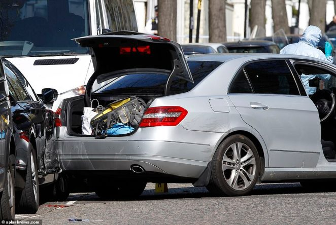The damage to a parked car can be seen by the boot of the Mercedes, which crashed into several parked vehicles outside the embassy