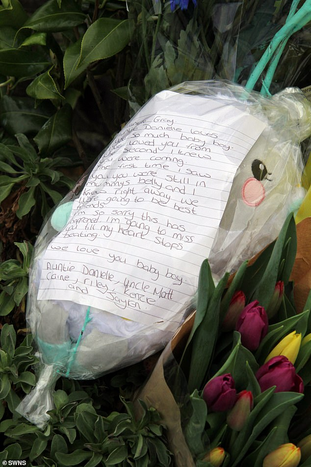 Relatives leave flowers and a cuddly toy at the entrance to Tencreek Holiday Park, Looe, Cornwall today